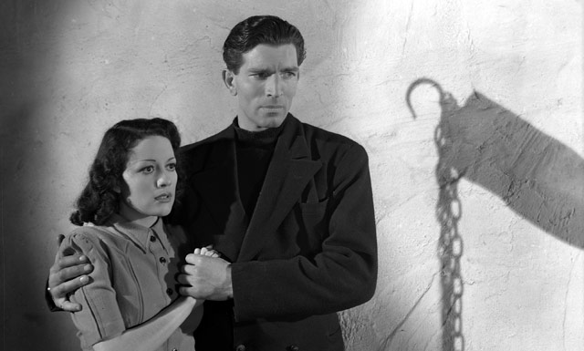 Marie and Anthony Hale (Michael Rennie) look out for the Navy